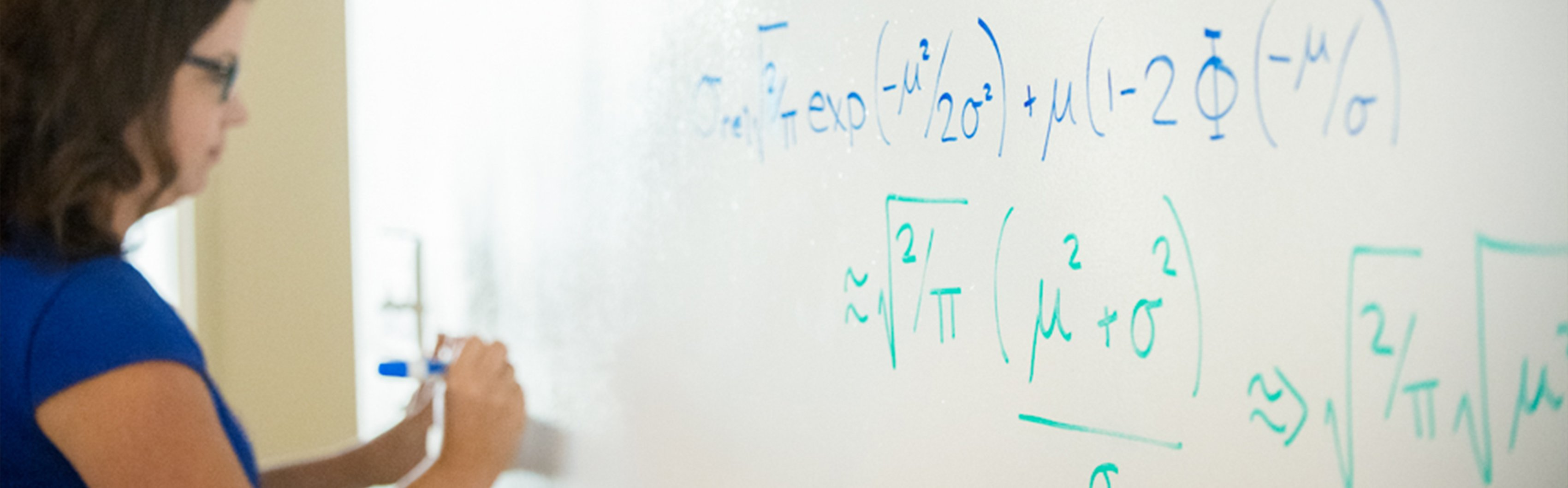 MR at whiteboard with formula